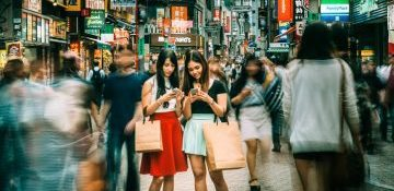 Japanese girlfriends hanging out on Shibuya streets of Tokyo. Japan.